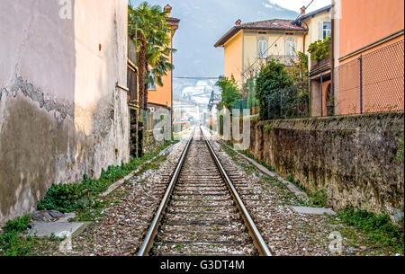 Brescia, Italy - February 16, 2013: the train tracks that pass through the town of Pisogne Lake Iseo - Stock Photo