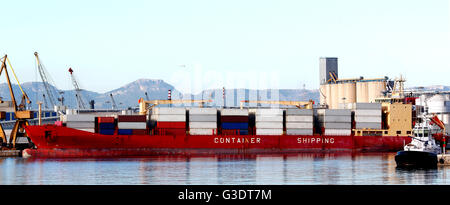Container ship at port, being unloaded - Stock Photo