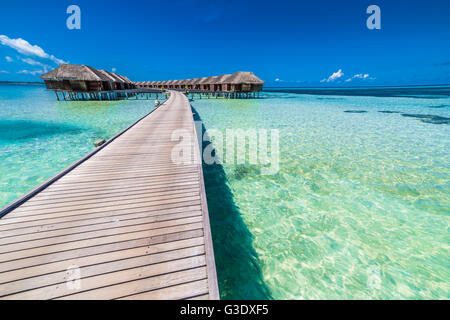 Amazing water villas on tropical and exotic, luxury island, Maldives - Stock Photo