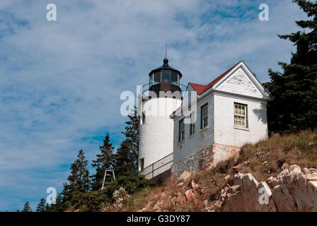 Bass Harbor lighthouse sits atop a rocky cliff in Acadia National Park, in Maine. - Stock Photo