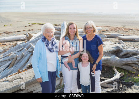 Four generations of women in a family posing on a beach; Fox Spit, Whidbey Island, Washington, United States of - Stock Photo