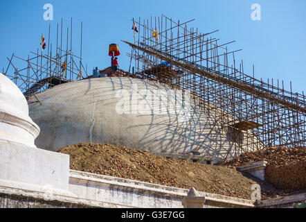 Kathmandu, Nepal - Circa February 2016: Reconstruction of Boudhanath stupa is under way after it was structurally - Stock Photo