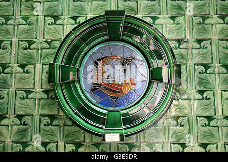 Stained glass fish by Christine Bedwell at Victoria Baths in Manchester - Stock Photo