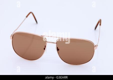 Brown aviator style sunglasses on white background - Stock Photo
