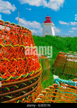 lighthouse and lobster pots in nova scotia canada - Stock Photo