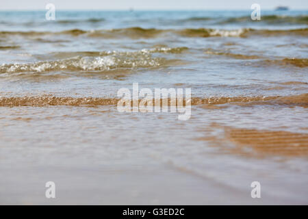 Little ripples in the sand from the sea on the beach - Stock Photo