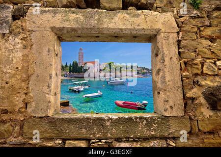 Hvar island church and stone beach window view, Dalmatia, Croatia - Stock Photo