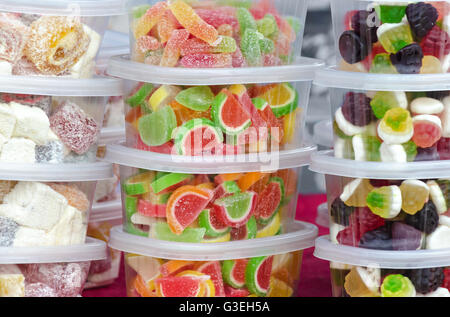 Candy in plastic containers on the market - Stock Photo
