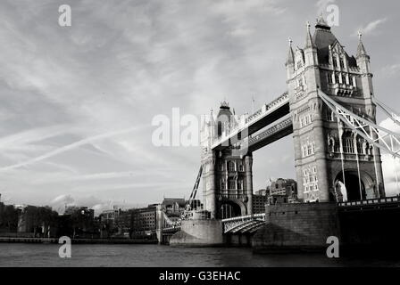 Tower Bridge London England UK Europe from the east catching the setting sun on a clear evening - Stock Photo
