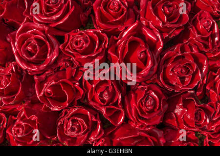 Red roses made of wax - Stock Photo