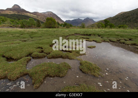 Village of Glencoe, Scotland. Picturesque overcast view of the banks of Loch Leven. - Stock Photo