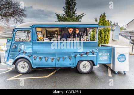Car portrait of a 1950's Citroen Van de Bar, rent a van mobile Bar with young couple serving - Stock Photo