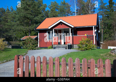 Swedish Style House traditional style swedish wooden painted house. overgrown unkempt