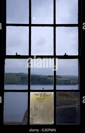 View of Charles Fort Summer Cove, Kinsale harbour through dirty window panes County Cork, Ireland - Stock Photo