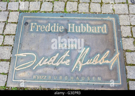alley ' In the Grüben ' as Street of Fame with recessed into the ground relief panels of jazz artists of the International - Stock Photo