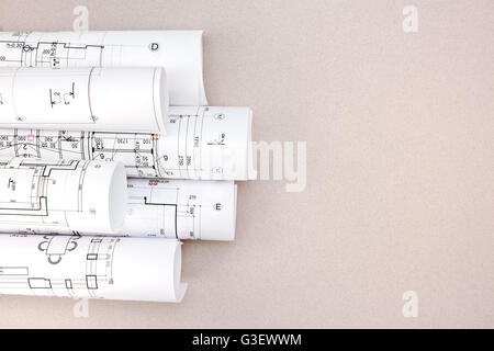 Top view of architectural house blueprints drawings and sketches 3d render rolls of architectural blueprints and house plans on the desk top view stock photo malvernweather Images