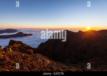above the clouds, view from the summit Roque de Los Muchachos on the mountains of the Caldera de Taburiente and - Stock Photo