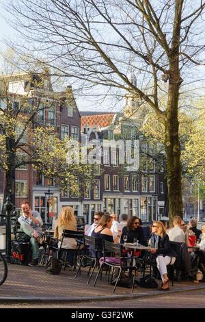 Prinsengracht corner Prinsenstraat, people in the street café, Amsterdam, Holland, Netherlands - Stock Photo