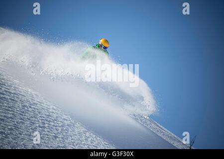 Snowboarder, downhill skiing, Powderspray - Stock Photo