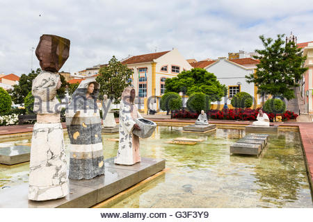 Sculptures on a square in front of city buildings, Praca al Mouhatamid Ibn Abbad, Silves, Algarve, Portugal - Stock Photo