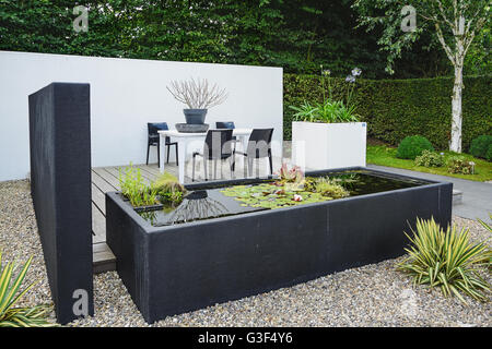 Garden With Modern Garden Furniture And Trendy Pond   Stock Photo