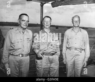 Admiral William F. Halsey (left), Secretary of the Navy Frank Knox (center) and Admiral Chester Nimitz (right). - Stock Photo