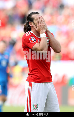 Wales' Gareth Bale rues a missed chance on goal during the UEFA Euro 2016, Group B match at the Stade de Bordeaux, - Stock Photo