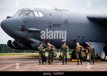 Crew members of a United States Air Force (USAF) Boeing B-52H Stratofortress strategic bomber of the 23d Bomb Squadron, parked on the pan at RAF Fairford airbase, as part of a US Air Force Global Strike Command deployment to Fairford, for military training exercises.