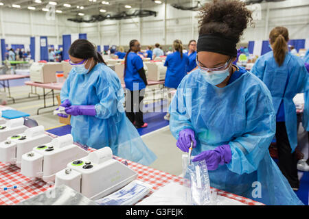 Warren, Michigan, USA. 10th June, 2016. Technicians seal sterilized dental tools in bags during a free two-day dental - Stock Photo
