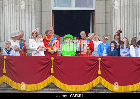 Royal Family viewing the Queen's Birthday Flypast from the balcony of the Palace after Trooping the Colour at Buckingham - Stock Photo