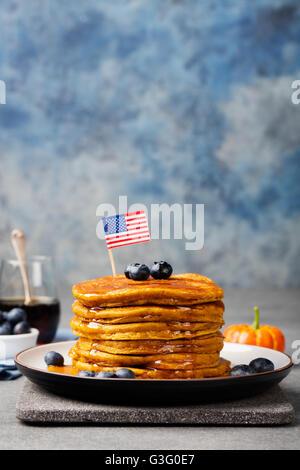 Pumpkin pancakes blueberries American flag on top - Stock Photo