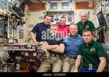 International Space Station Expedition 47 crew members pose for a group photo April 30, 2016 in Earth Orbit. Front - Stock Photo
