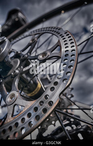 steel metal disc brake on road bike giving great sharp breaking stopping ability but knife sharp edges risk of cuts - Stock Photo