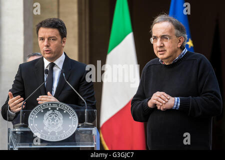 Italian Prime Minister Matteo Renzi (L) and Sergio Marchionne (R), CEO of Fiat Chrysler Automobiles (FCA) attend - Stock Photo