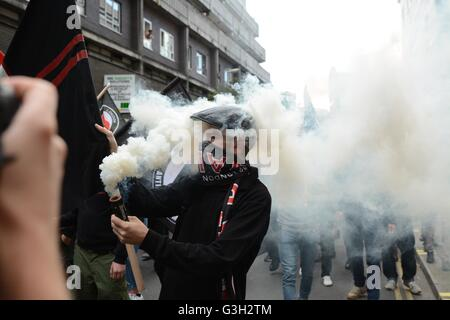 London, UK. 24 June, 2016. Pro-europe and migrant rally held in London.  Smoke engulfs the street. Credit:  Marc - Stock Photo