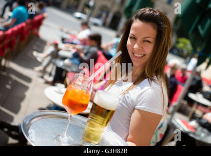 Munich, Germany. 20th June, 2016. Waitress Desislava carrying beverages at Café Luigi Tambosi in Munich, Germany, - Stock Photo