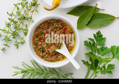 Chimichurri sauce from Argentina with ingredients - Stock Photo