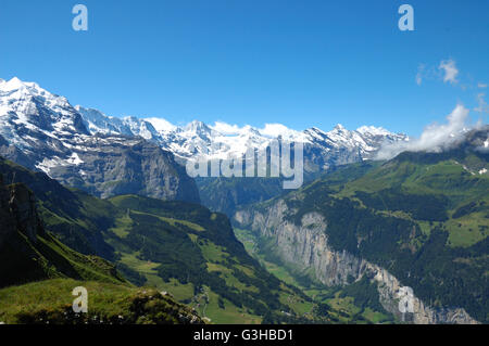 Lauterbrunnen valley in the Swiss Bernese Oberland with the snowcapped peaks of the Alps in the background. - Stock Photo
