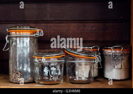 Kilner jars on shelf - Stock Photo