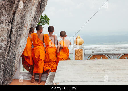 Krabi, Thailand - April 10, 2016: Novice monks are observing hilltop of the Tiger Cave Mountain Temple on in Krabi - Stock Photo