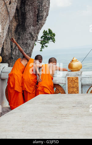 Krabi, Thailand - April 10, 2016: Novice monks are observing hilltop of the Tiger Cave Mountain Temple in Krabi. - Stock Photo