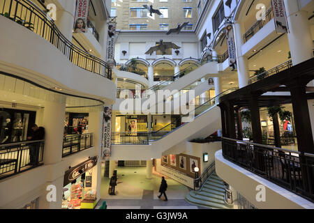 Interior view of Les Cours Mont-Royal a upscale shopping center in downtown Montreal.Quebec,Canada - Stock Photo