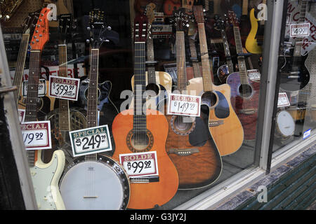Guitars Displaying In The Window Of A Musical Instrument Store Old Montreal Quebec Canada