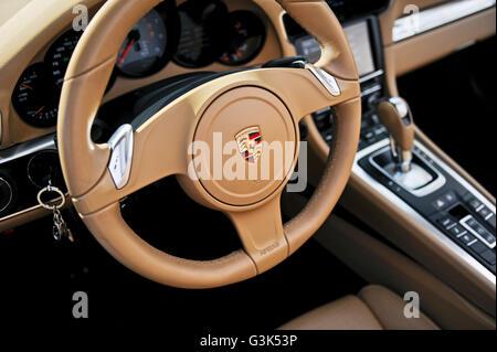 The interior dashboard, steering wheel and console of a Porsche 911 Carrera S - Stock Photo