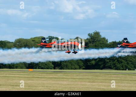The Blades a British civilian aerobatic team flying the Extra Flugzeugbau EA300 aircraft - Stock Photo