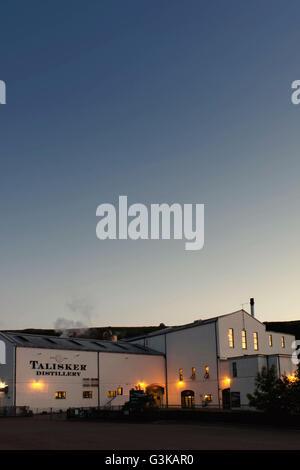The Talisker Whisky Distillery, Skye, Scotland at dusk on an clear summers evening.