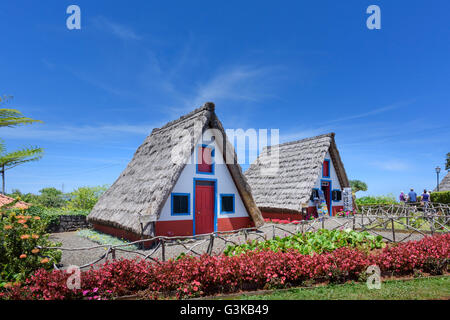 Traditional palheiros - thatched triangular houses in Santana Madeira - Stock Photo