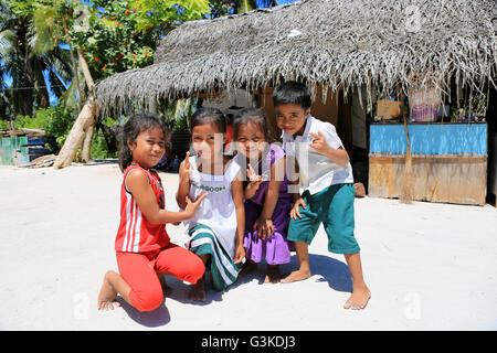 Local children posing near kindergarten, Christmas Island, Kiribati - Stock Photo