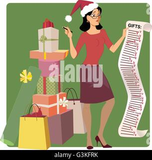 Stressed woman in a Santa hat crossing out names from a long Christmas shopping list, pile of gifts at her feet - Stock Photo