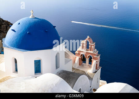 Oia town on Santorini island, Greece. Traditional and famous houses and churches with blue domes over the Caldera, - Stock Photo